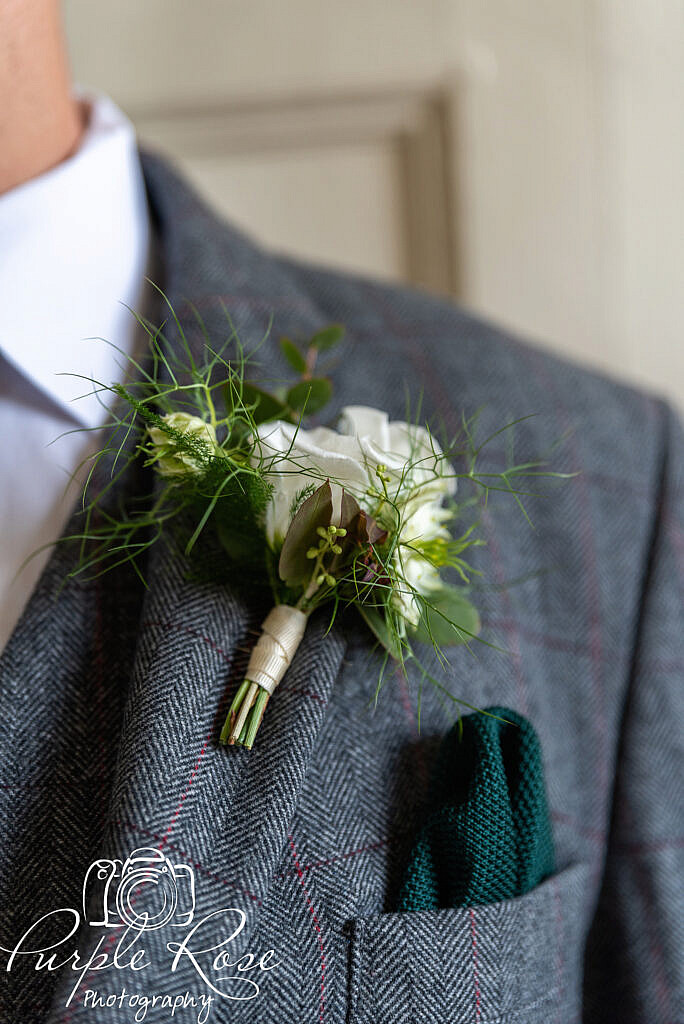 Groom wearing his button hole