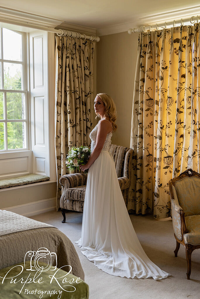 Bride standing in the bridal suite
