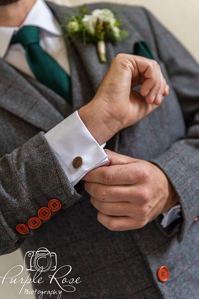 Groom adjusting his cufflinks