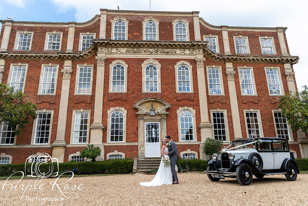 Bride and groom in front of Chicheley Hall