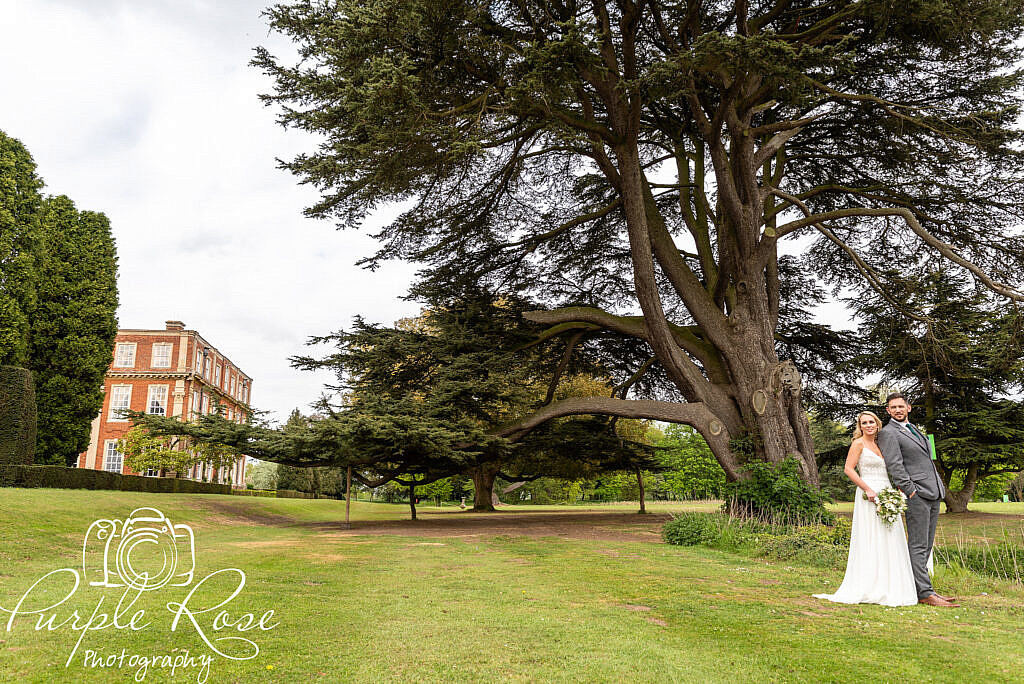 Bride and groom with Chicheley Hall in the background