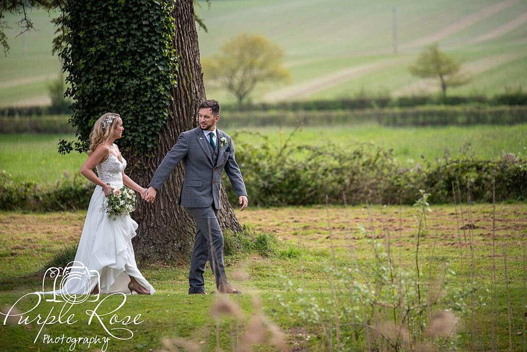 Bride and groom strolling