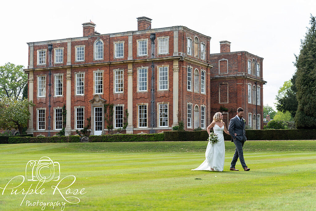 Bride and groom strolling round their venue