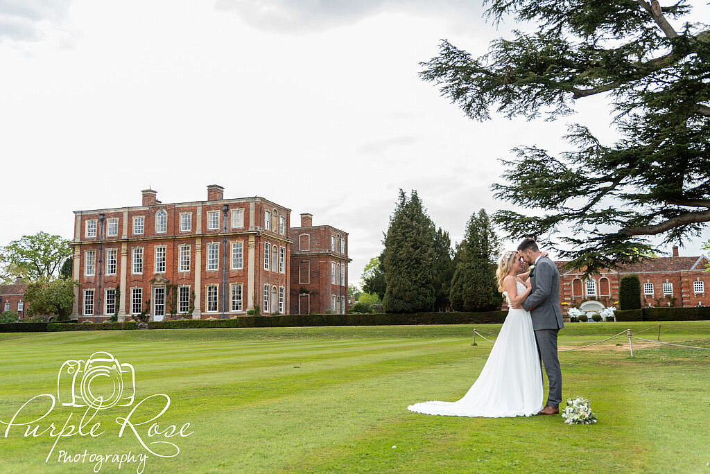 Bride and groom relaxing in their venues gardens