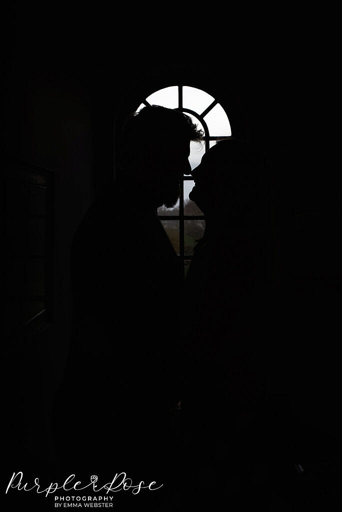 Silhouette of a couple in a window