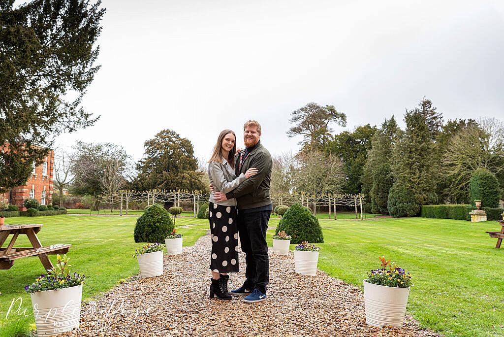 Couple hugging in a garden