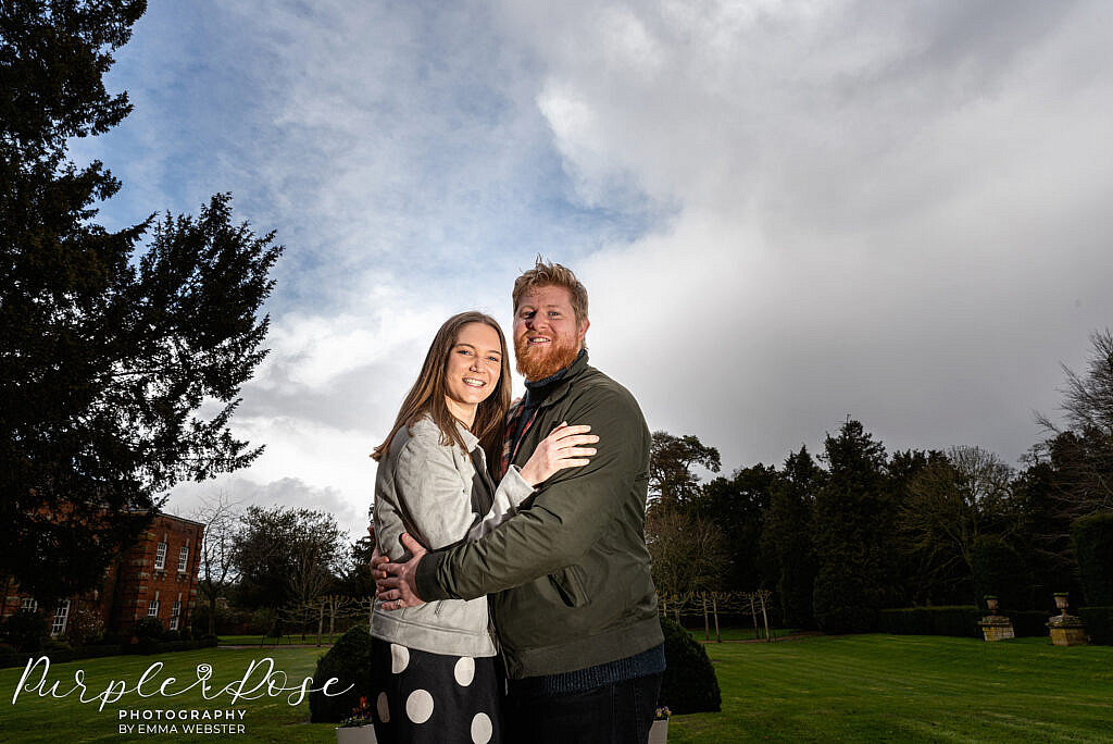 Couple standing in and English garden
