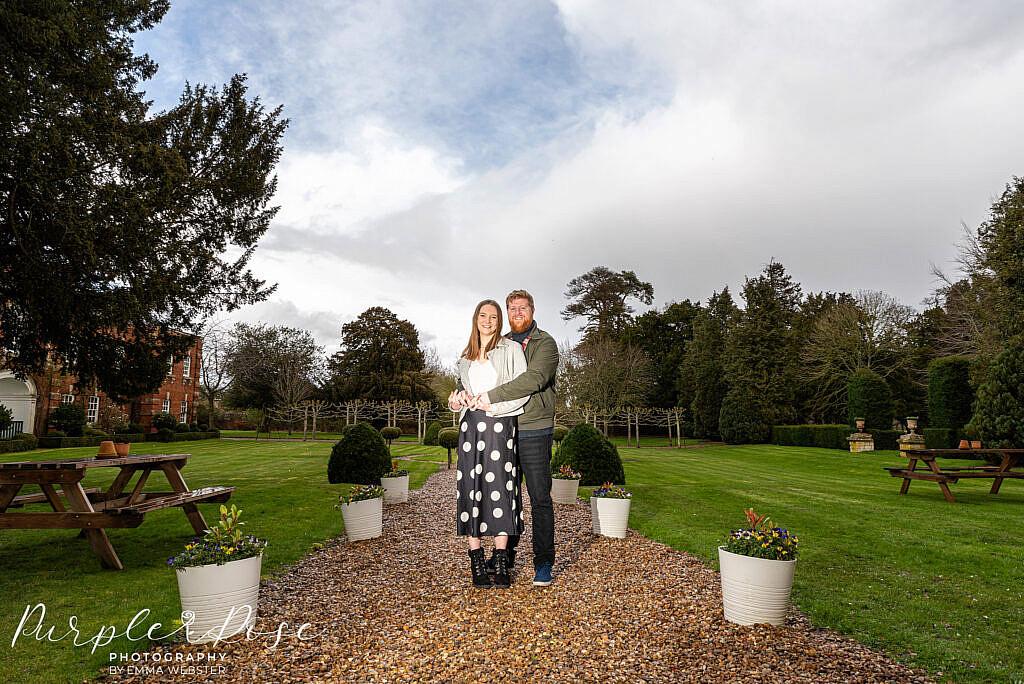 Couple standing in a garden