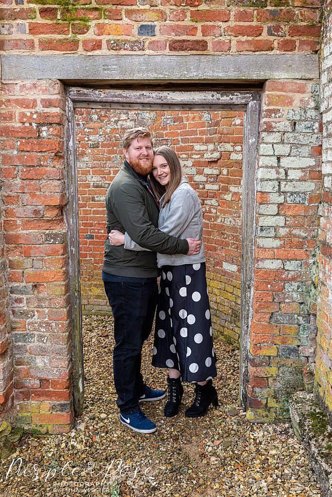 Couple standing in a doorway