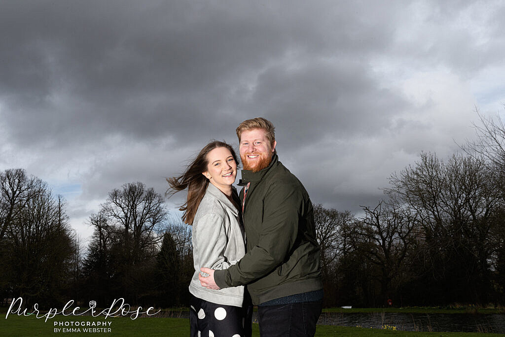 Couple in front of a stormy sky