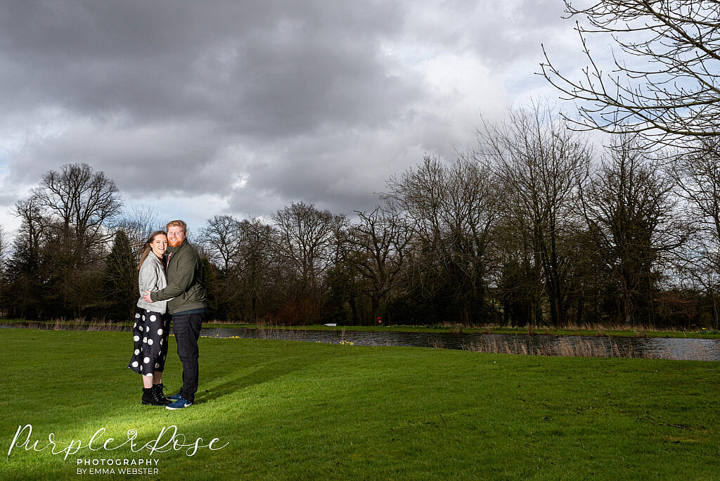 Couple with a dramatic sky behind them