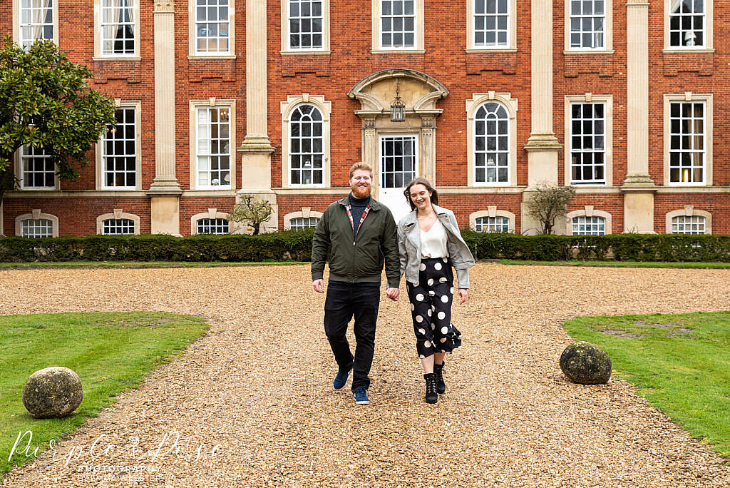 Couple walking away from Chicheley Hall