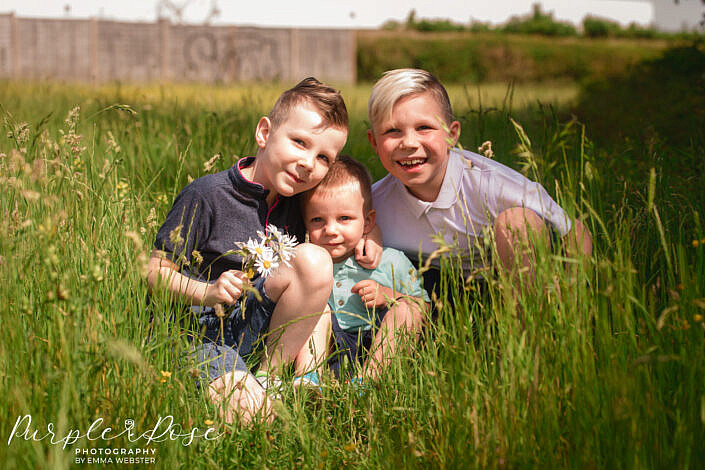 Brothers hugging in a field