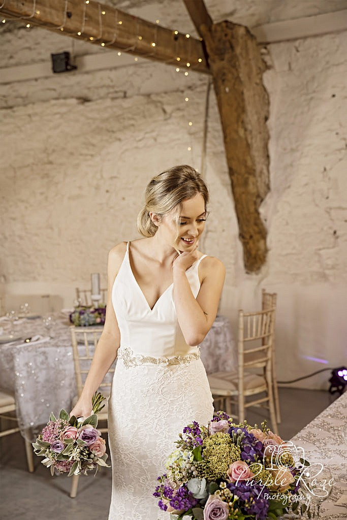 Bride admiring her flowers