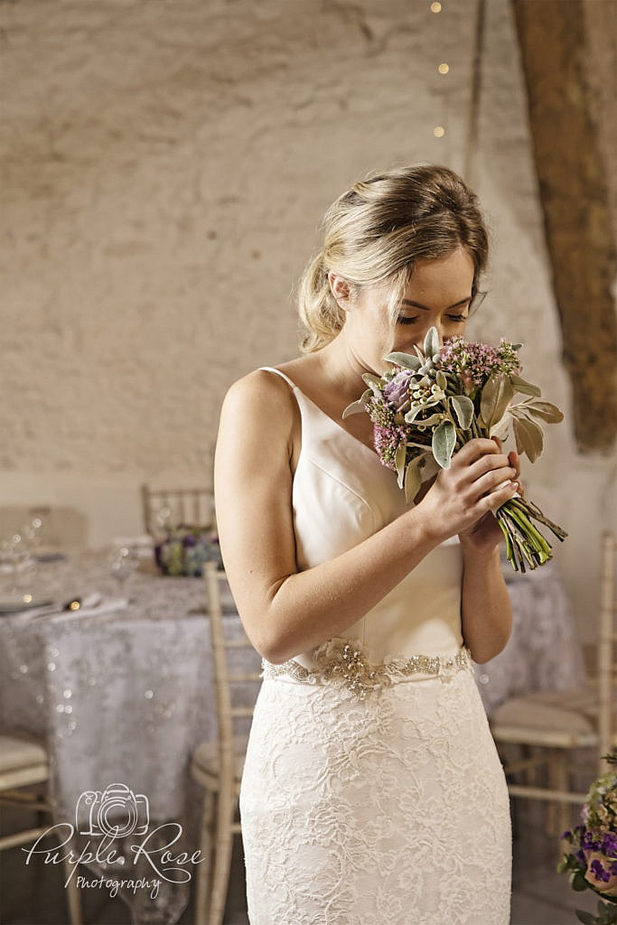 Bride smelling her bouquet