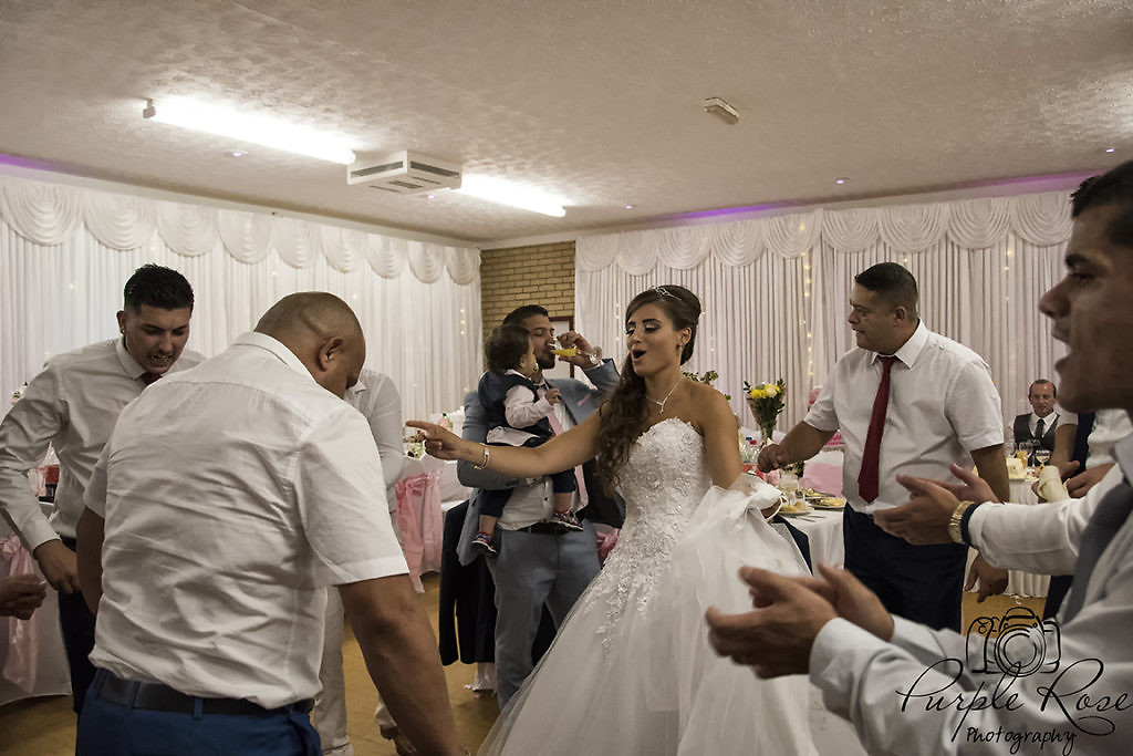Bride dancing with her guests