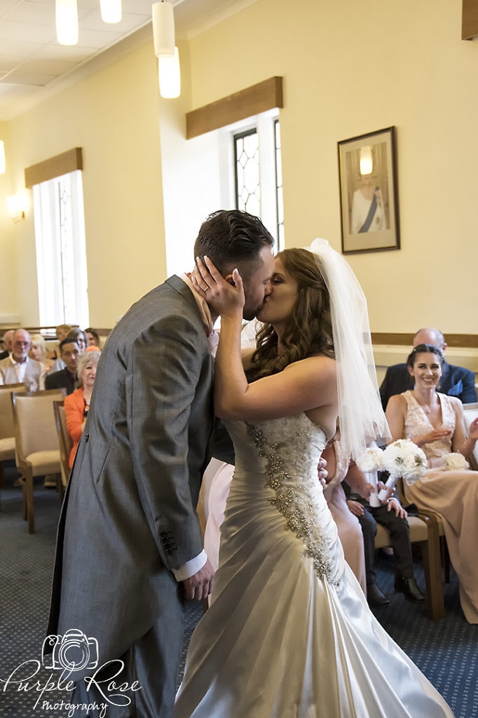 Bride and groom sharing their first kiss