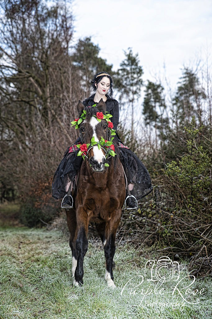 Gothic lady riding a horse