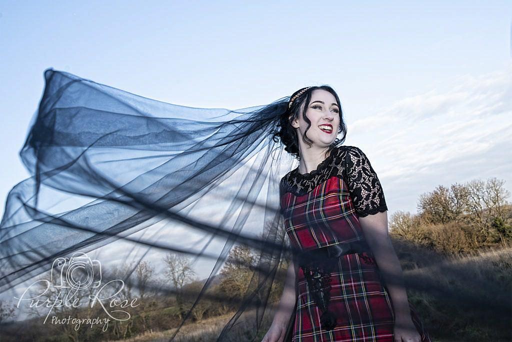 Gothic bride with black wedding veil