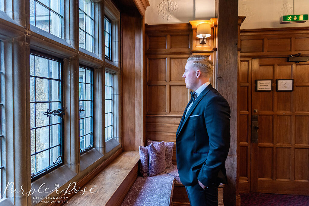 Groom looking out the window