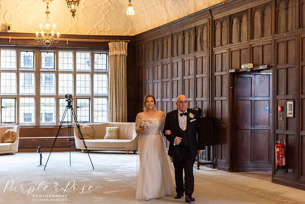 Bride walking into the ceremony with her father