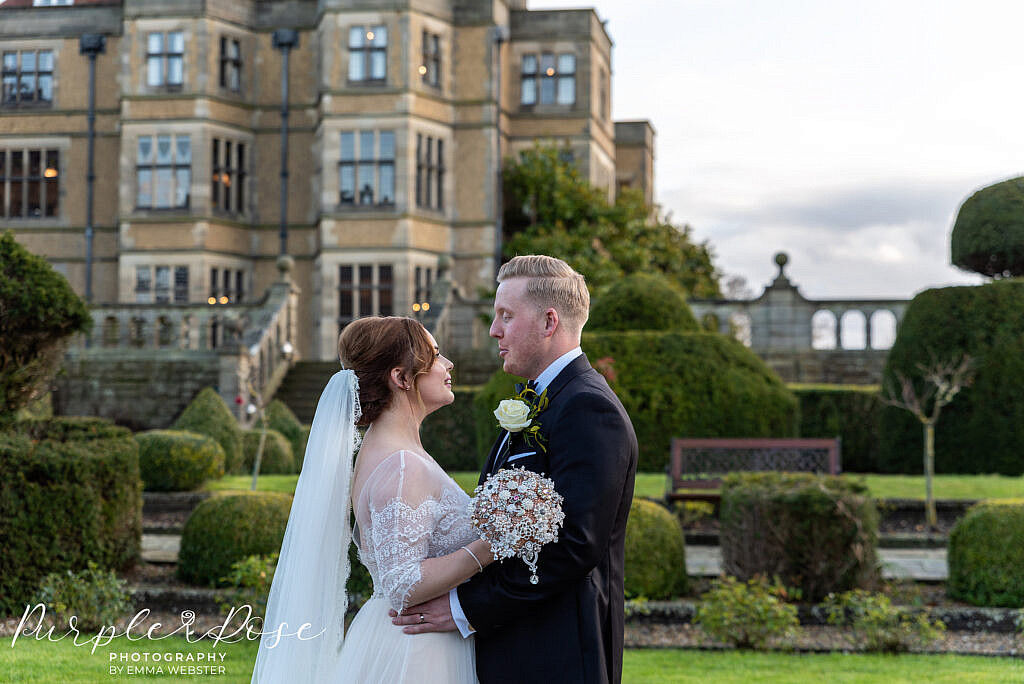 Bride and groom in the grounds of Farnham hall