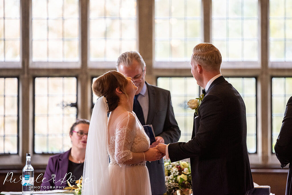 Bride and groom laughing during their wedding ceremony