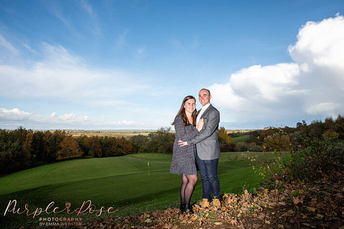 Couple stood in front of gold course