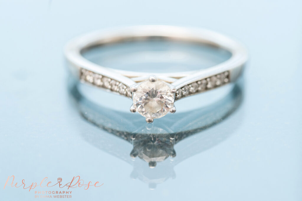 Bride engagement ring on a mirror