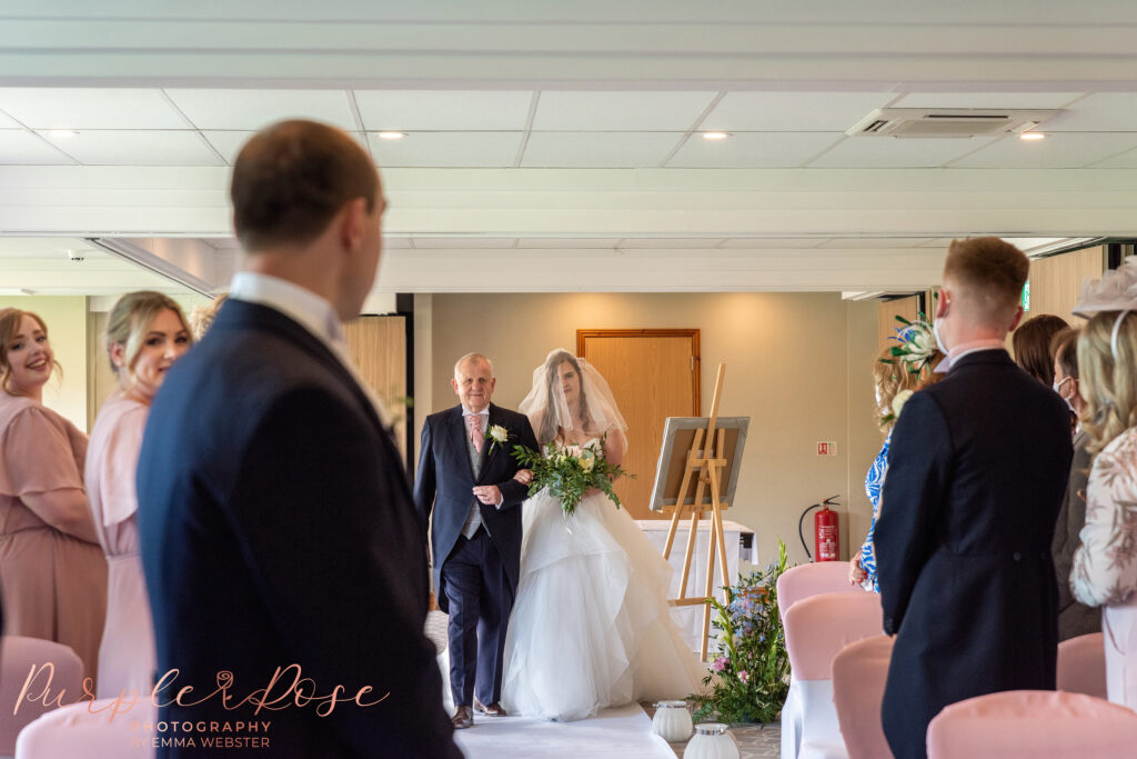 Groom turning to see his brides arrival