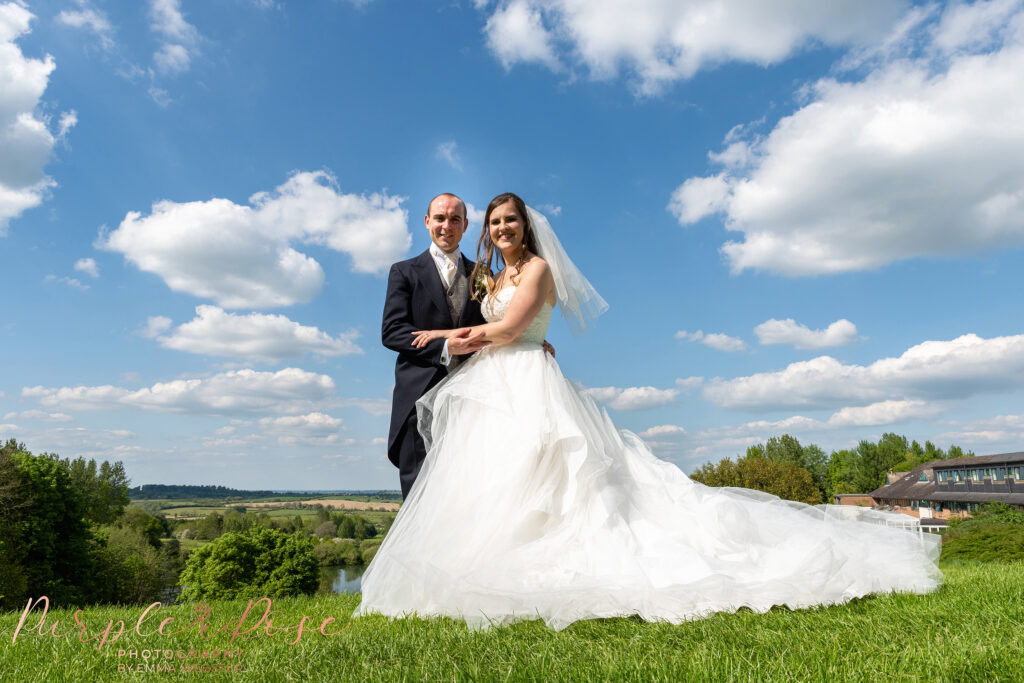 Bride and groom outside on a sunny day