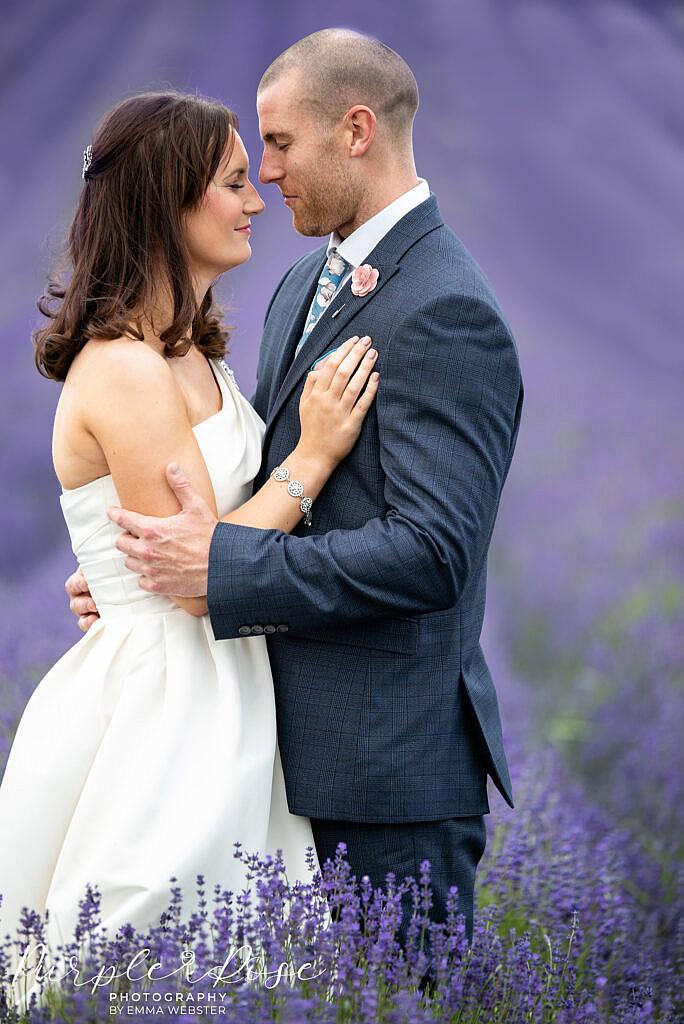Bride and groom standing in Lavender field