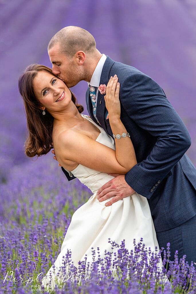 Bride and groom in a lavender field