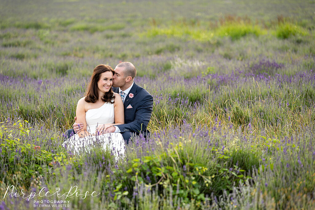 Bride and groom sat in a lavender field