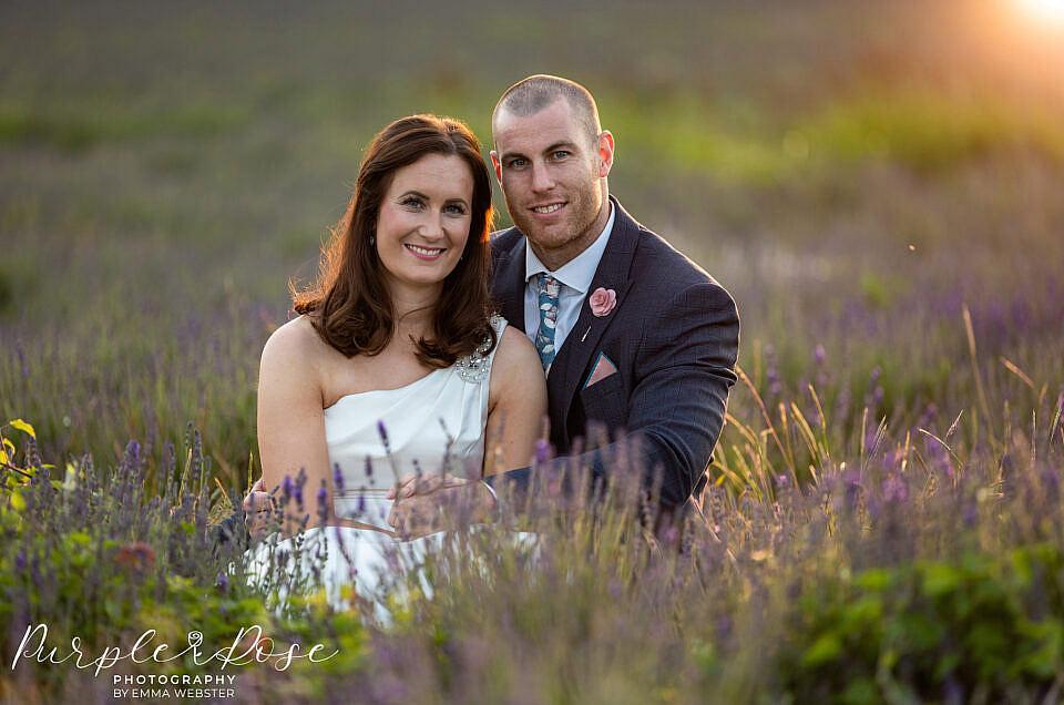 Bride and groom bathed in golden light