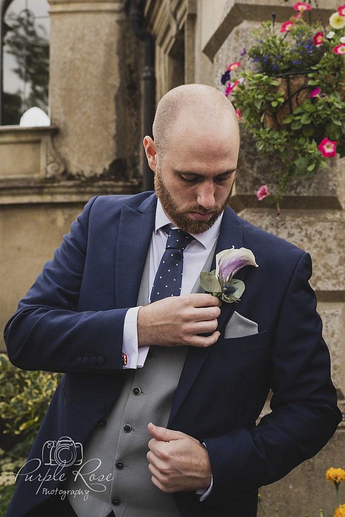 Groom checking his buttonhole