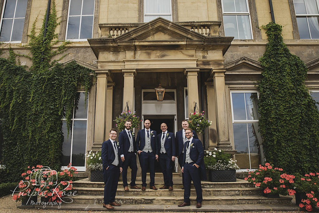 Groomsmen in front of the wedding venue