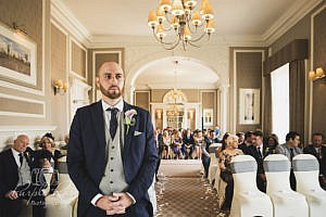 Groom waiting for his bride in the wedding ceremony room
