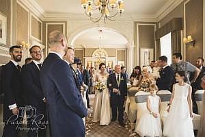 Bride walking towards her groom
