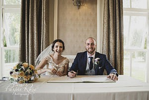 Bride and groom signing the registra