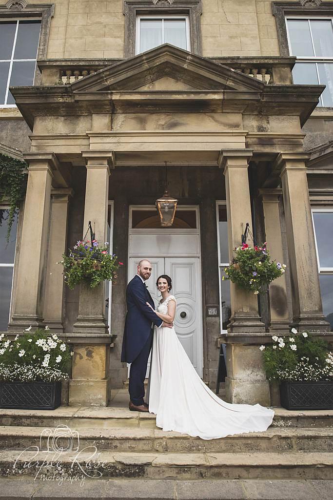 Bride and groom stood in a doorway