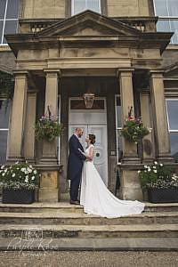 Bride and groom standing together on steps