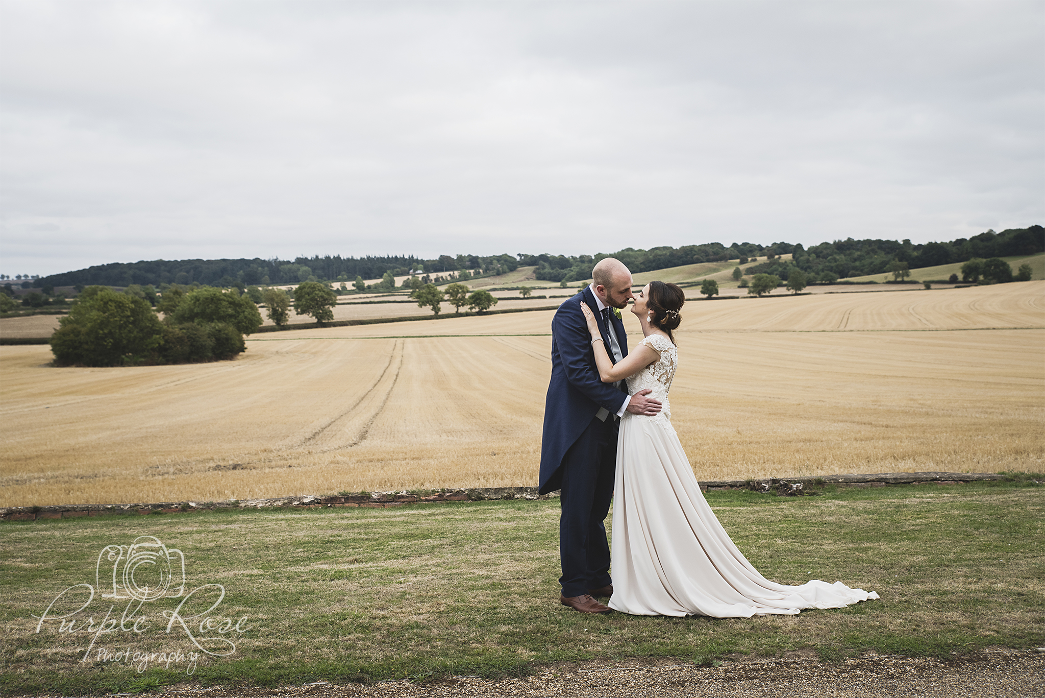 Bride and groom in front off an open field