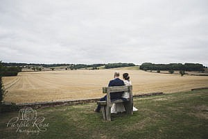 Bride and groom sitting alone for a quiet moment