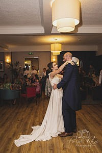 Bride and groom looking into each others eyes while dancing