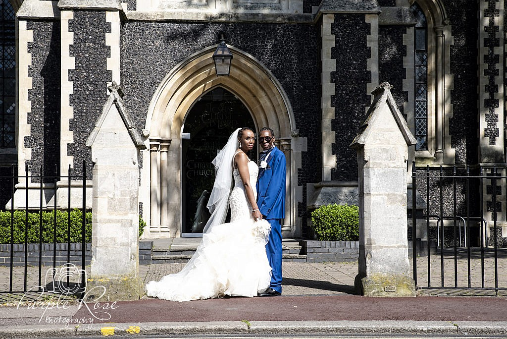 Bride and groom standing in front of their church