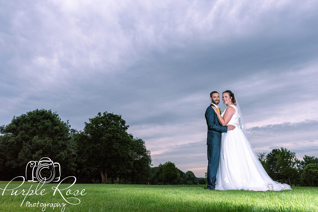 Bride and groom in front of a sunset