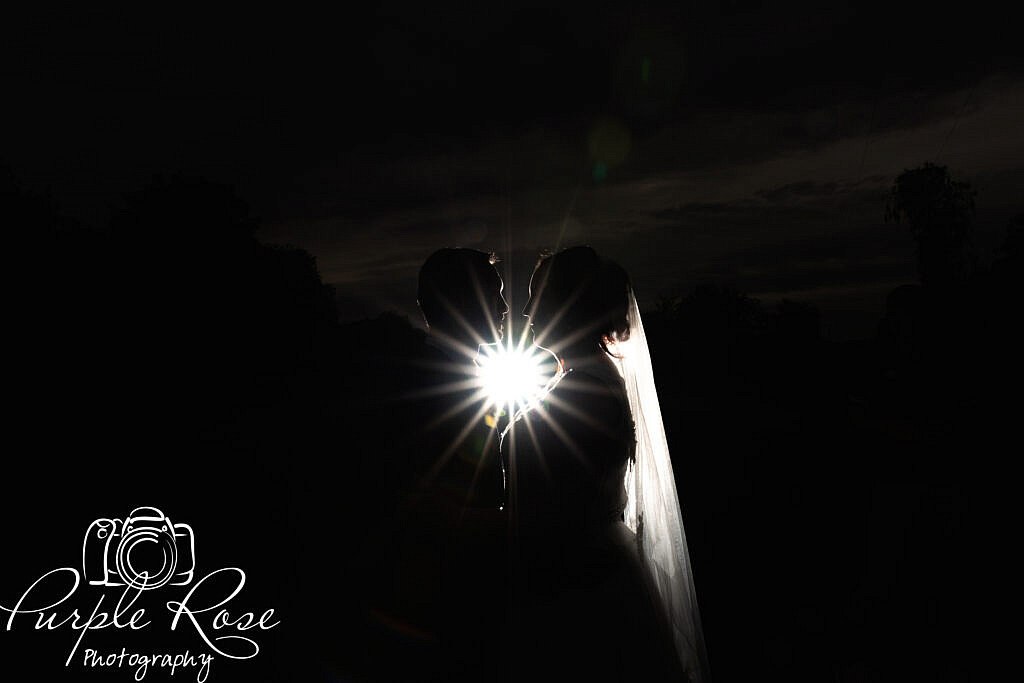 Night time silhouette of bride and groom