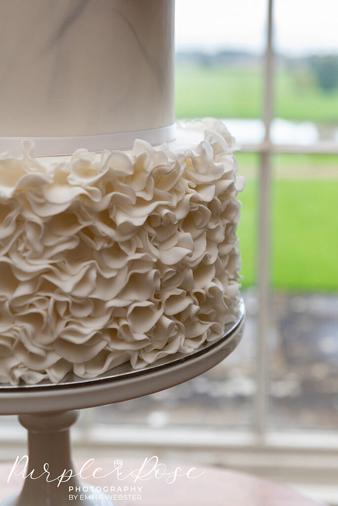 Intricate details on a wedding cake
