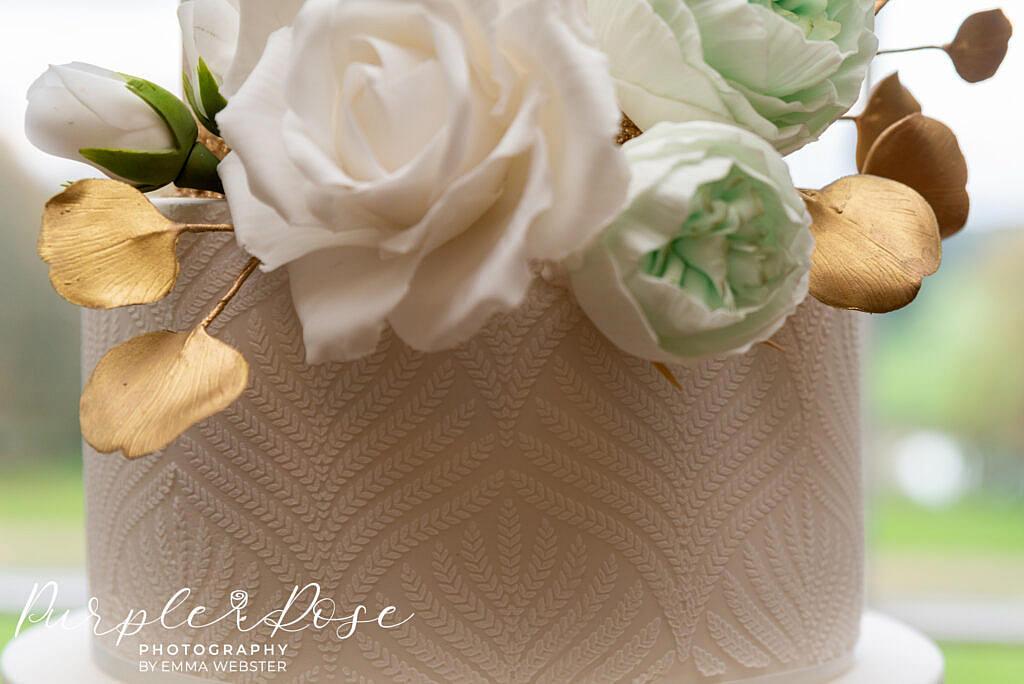 Close up of intricate details on a wedding cake at Kelmarsh Hall Northampton